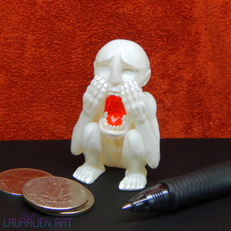 A small, handpainted figurine of SCP-096: The Shy Guy Monster