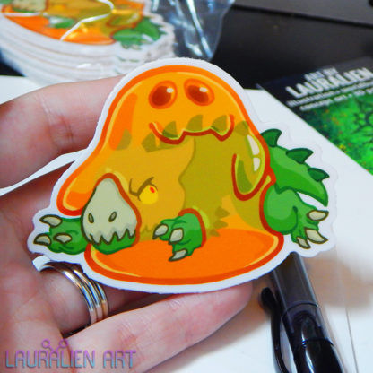 """A 3"""" sticker of a cute cartoon of a happy SCP-999 engulfing an angry SCP-682"""