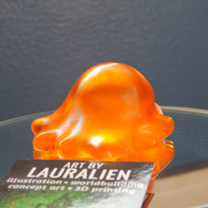A small, handpainted figurine of SCP-999: The Tickle Slime Monster