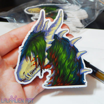 """A 3"""" sticker of a detailed portrait of SCP-682, the lizard monster"""