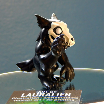 A small, handpainted werewolf figurine. Its name is malO and it wants to be your friend.