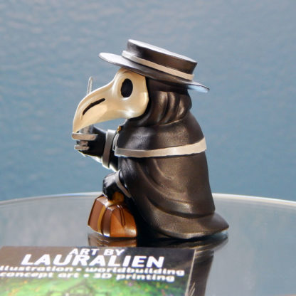A small, handpainted plague doctor figurine. It holds a leather bag and syringe.
