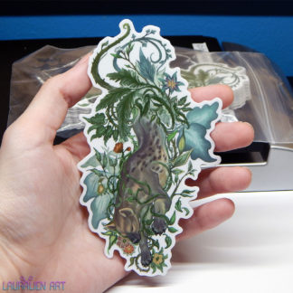 """A 5"""" sticker of a tranquil hyena surrounded by leafy foliage"""