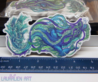 """A 5"""" sticker of a ferocious chinese dragon, engulfed in water"""